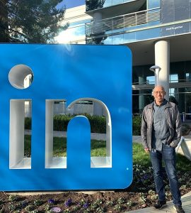 Chris Louie standing in front of LinkedIn sign at LinkedIn campus.