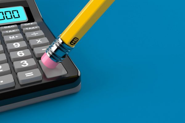 Photo of a calculator and a pencil. The pencil is turned upside down and the eraser is being used to clear the figures on the calculator.
